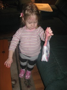 Trying out her new Dora purse