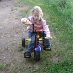 On her hand cycle